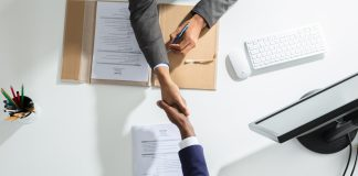 Videoslots agreement, hands shaking across a table