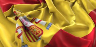 80737601 - spain flag ruffled beautifully waving macro close-up shot