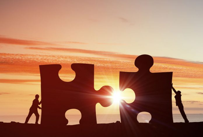 50358765 - business people connecting puzzle elements representing collaboration concept