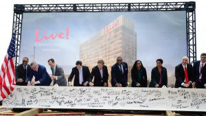 PHL_Top_Off___Signing_the_Beam-e1572865280794-300x169.jpg