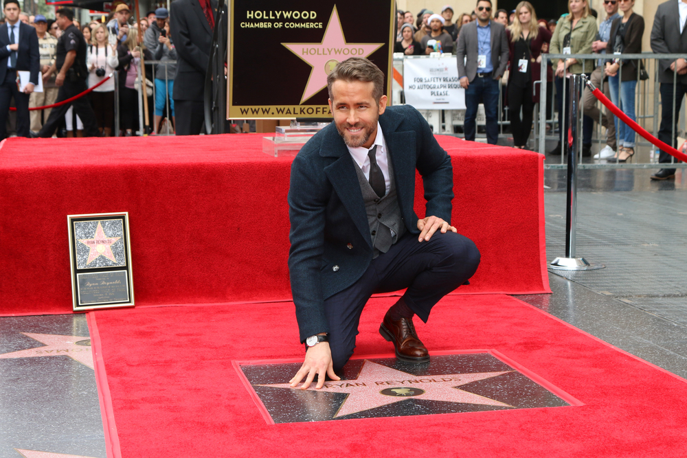Hollywood pair Ryan Reynolds and Rob McElhenneyseal deal to buy Wrexham