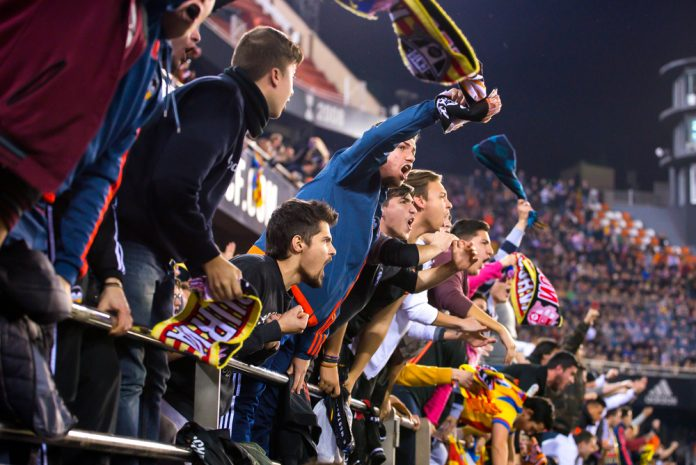 Valencia CF supporters celebrate at a La Liga match between Valencia and Real Madrid
