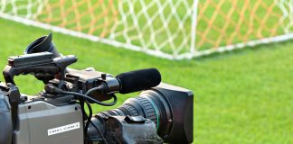 Television camera at the side of a football pitch