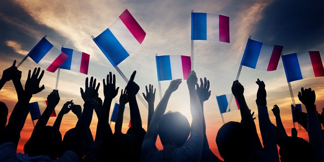 Vbet - Group of People Waving French Flags in Back Lit