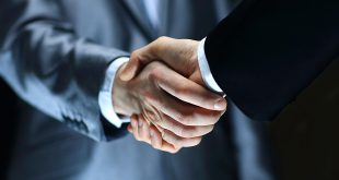 GLMS - Handshake - Hand holding on black background