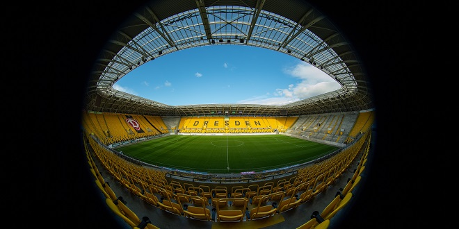 """Germany - 12 March 2020, Saxony, Dresden: Football: 2nd Bundesliga, SG Dynamo Dresden. View into the empty Rudolf-Harbig-Stadium. Numerous football matches in Germany and Europe are currently taking place without spectators. It is not yet clear whether so-called """"ghost games"""" will also take place here because of the new corona virus. Photo: Robert Michael/dpa-Zentralbild/dpa - IMPORTANT NOTE: In accordance with the regulations of the DFL Deutsche Fußball Liga and the DFB Deutscher Fußball-Bund, it is prohibited to exploit or have exploited in the stadium and/or from the game taken photographs in the form of sequence images and/or video-like photo series."""