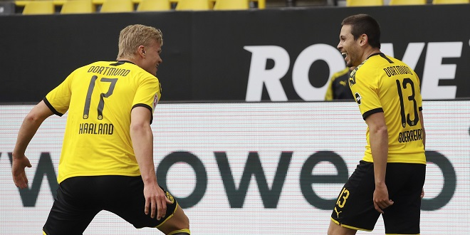 Bundesliga - jubilation Raphael GUERREIRO (DO) after his goal for 2: 0, l. Erling HAALAND (DO) Soccer 1.Bundesliga, 26th matchday, Borussia Dortmund (DO) - FC Schalke 04 (GE), on May 16, 2020 in Dortmund / Germany. Photo: Ralf Ibing / firosportphoto / POOL via PHOTO AGENCY SVEN SIMON For journalistic purposes only! Only for editorial use! ## Gemvssvu the requirements of the DFL Deutsche Fuvuball Liga, it is prohibited to use or have in the stadium and / or photos taken from the game in the form of sequence pictures and / or video-like photo series. DFL regulations prohibit any use of photographs as image sequences and / or quasi-video. ## ¬ | usage worldwide