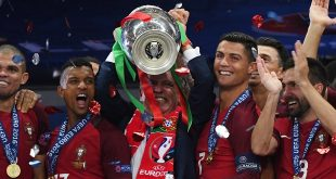 Simulated Reality - Fernando Santos(C), coach of Portugal celebrates with the trophy during the awarding ceremony after winning the Euro 2016 final football match against France in Paris, France, July 10, 2016. Portugal won 1-0.(Xinhua/Guo Yong) (Photo by Xinhua/Sipa USA)