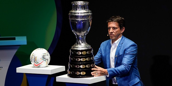 Stats Perform - (191205) -- BEIJING, Dec. 5, 2019 (Xinhua) -- Brazilian former football player Juninho Paulista presents the Copa America trophy on the stage during the draw for the 2020 Copa America football tournament in Cartagena, Colombia, Dec. 3, 2019. (Photo by Jhon Paz/Xinhua)