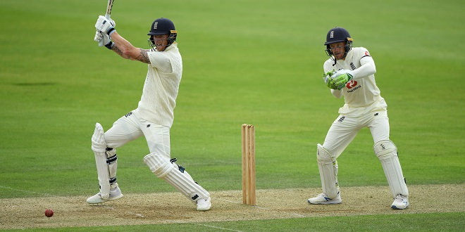 cricket - England's Ben Stokes hits a boundary as Jos Buttler looks on during day two of a Warm Up match at the Ageas Bowl, Southampton.