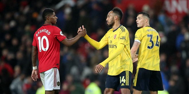 Normal Football - Manchester United's Marcus Rashford and Arsenal's Pierre-Emerick Aubameyang shakes hands after the Premier League match at Old Trafford, Manchester.