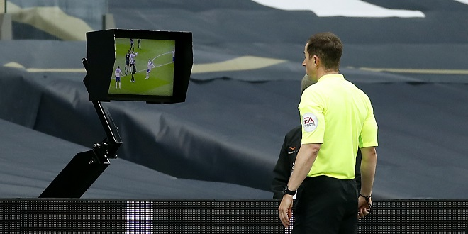 penalties - Referee Peter Bankes checks the VAR pitch side monitor before giving a penalty for a hand ball against Tottenham Hotspur's Eric Dier during the Premier League match at Tottenham Hotspur Stadium, London.