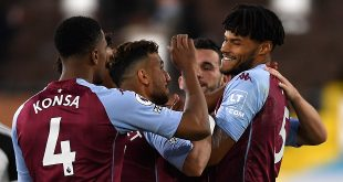 defenders - Aston Villa's Tyrone Mings (right) celebrates scoring his side's third goal of the game during the Premier League match at Craven Cottage, London.