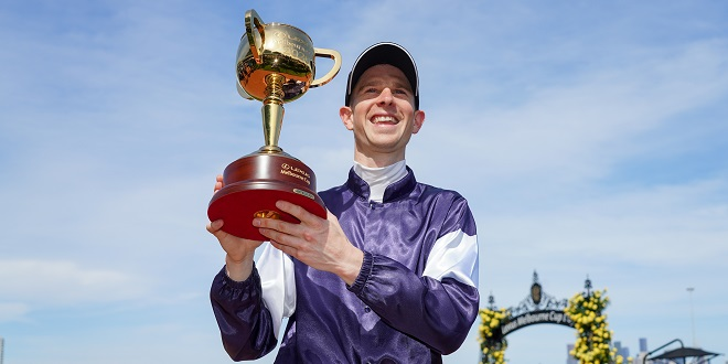 Melbourne Cup - Jockey Jye McNeil holds the Lexus Melbourne Cup after riding Twilight Payment to victory in race 7, The Lexus Melbourne Cup, during Melbourne Cup Day at Flemington Racecourse in Melbourne, Tuesday, November 3, 2020. (AAP Image/Racing Photos, Scott Barbour) NO ARCHIVING, EDITORIAL USE ONLY ** STRICTLY EDITORIAL USE ONLY, NO COMMERCIAL USE, NO BOOKS **